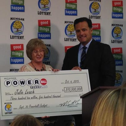Julie Leach is presented with her $310.5M winning lottery