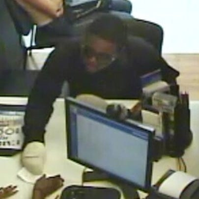 Surveillance footage shows the robber handing the threatening