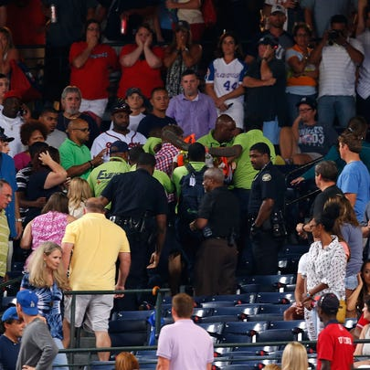 Emergency medical staff help a fan that fell from the