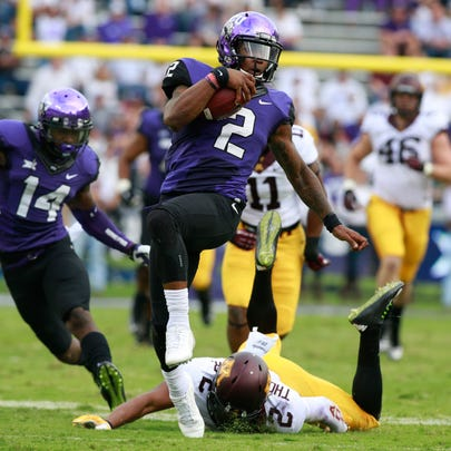 Trevone Boykin (2) runs with the ball in the fourth
