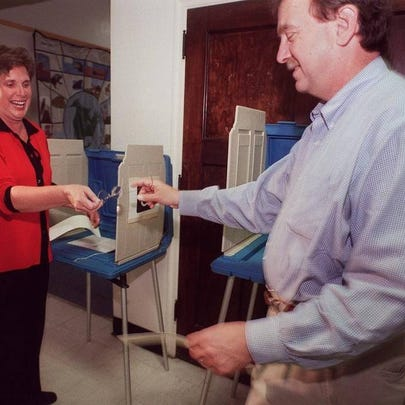 Cathy and Darrell Hirt shared a laugh casting votes