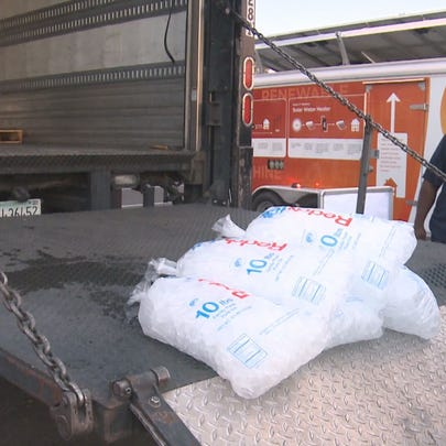 APS workers distribute ice to residents without power