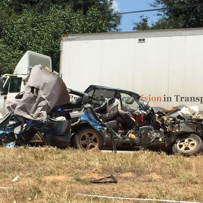 A baby was killed when a car crashed into a big rig