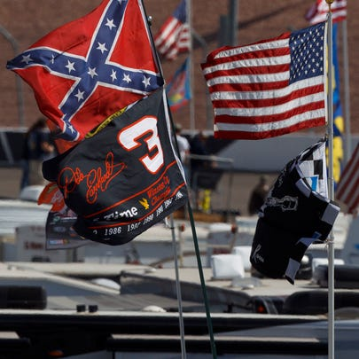 Detailed view of a confederate flag and Dale Earnhardt
