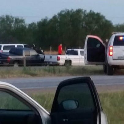 A standoff with an armed man has forced I-35 to be
