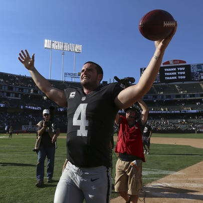 Oakland Raiders quarterback Derek Carr (4) celebrates