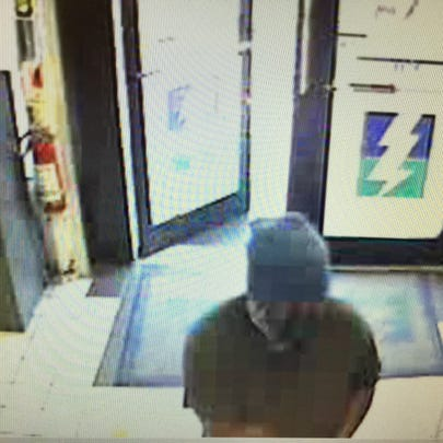 Surveillance photo of the masked man who reportedly
