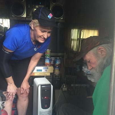 Delivery driver Angela Nguyen talks with 76-year-old