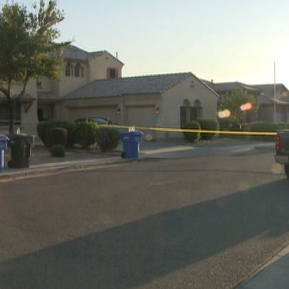 Police say an armed resident shot at robbers trying