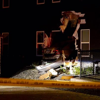 A car drove into an apartment building early Tuesday