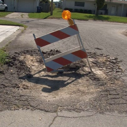 Roads in the Holiday Hill subdivision are riddled with