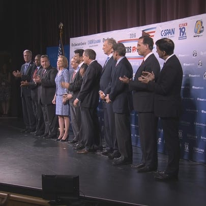 The GOP presidential candidates stand on stage during