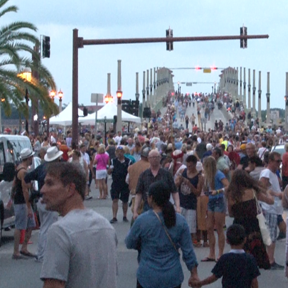 Crowd gathers Friday night by the main stage at the
