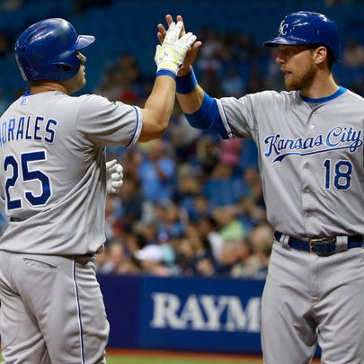Royals designated hitter Kendrys Morales (25) greets