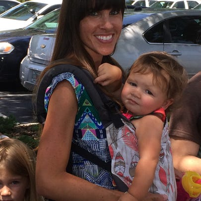 Erica Kalnins was carrying her 5-year-old daughter