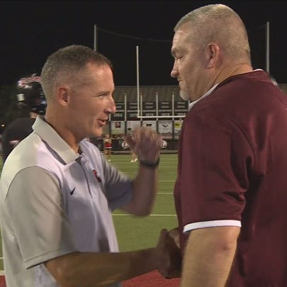 George Quarles and Rob Black shake hands following