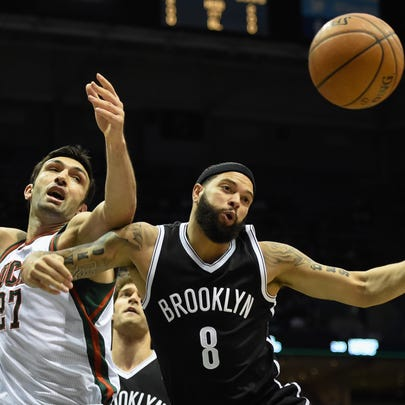 Milwaukee's Zaza Pachulia (27) and Brooklyn's Deron