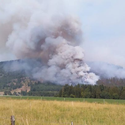 Officials reported a brush fire near Colville temporarily
