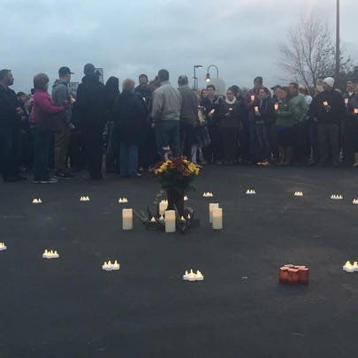At a candlelight vigil for Brunn at the Holiday Inn