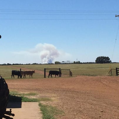 Smoke rises from a fire east of Paige in Bastrop County.