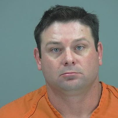 Timothy Morris, 40, the officer arrested on charges