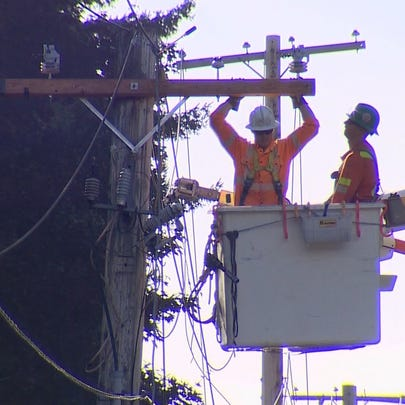 A line crew works to restore power on August 30, 2015.