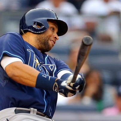 Tampa Bay Rays first baseman James Loney (21) hits