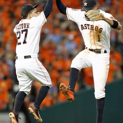 HOUSTON, TX - JUNE 30: Jose Altuve #27 and Carlos Correa