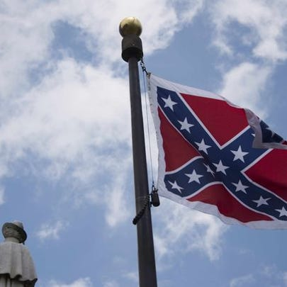 The confederate flag flies on the grounds of the South