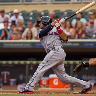 The Indians Mike Aviles hits a homer in the 10th inning