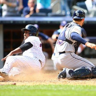 New York Yankees pinch runner Jose Pirela (38) scores