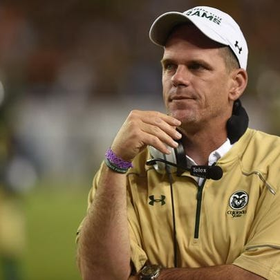 CSU football coach Mike Bobo looks onto the field during