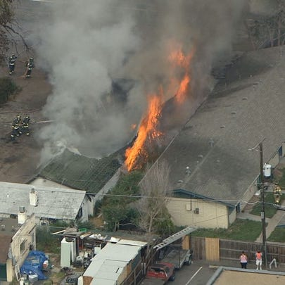 A structure fire burning in Lakewood is threatening