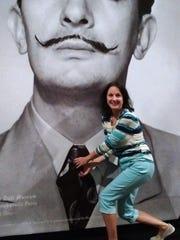 Cassie Tucker straightens the artist's tie at the Salvador
