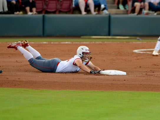 UL catcher Lexie Elkins dives head first into second
