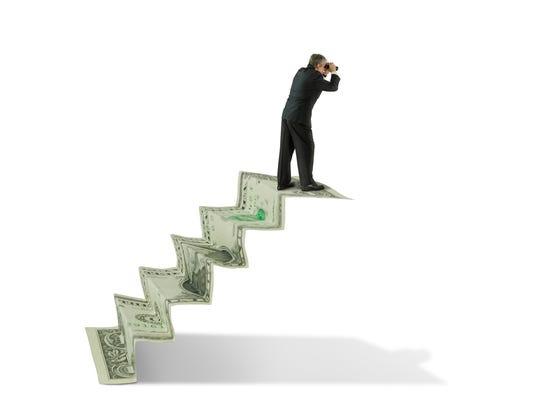 Man with binoculars on money stairs seeking financial advice