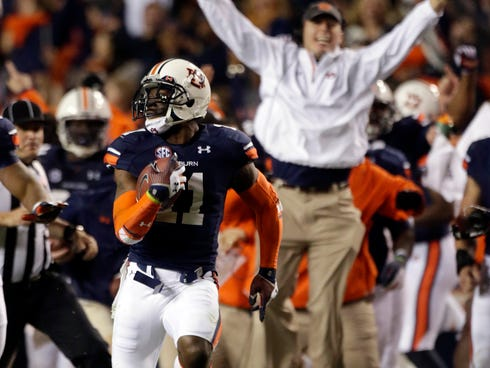 Auburn cornerback Chris Davis (11) returns a missed field goal attempt 100-plus yards to score the game-winning touchdown as time expired in the fourth quarter of an NCAA college football game against No. 1 Alabama in Auburn, Ala.