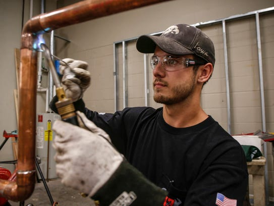 Matt Curry solders piping at the Plumbers and Steamfitters