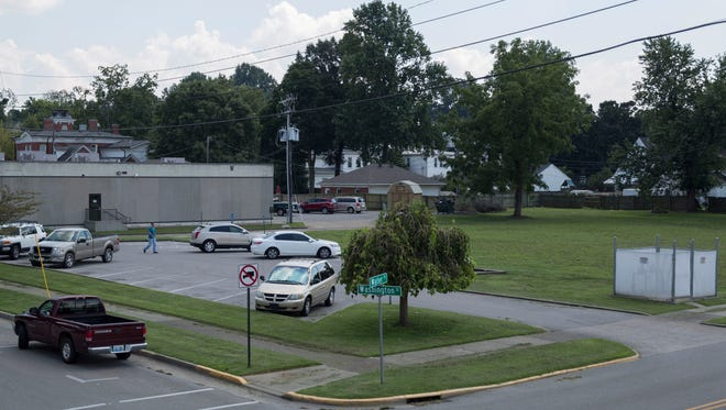 The Henderson County Public Library plans to expand along Washington and Water streets, where the parking lot currently is and the parcel next to it.