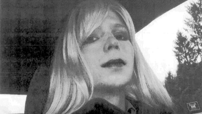 In this undated file photo, Pfc. Bradley Manning poses for a photo wearing a wig and lipstick.