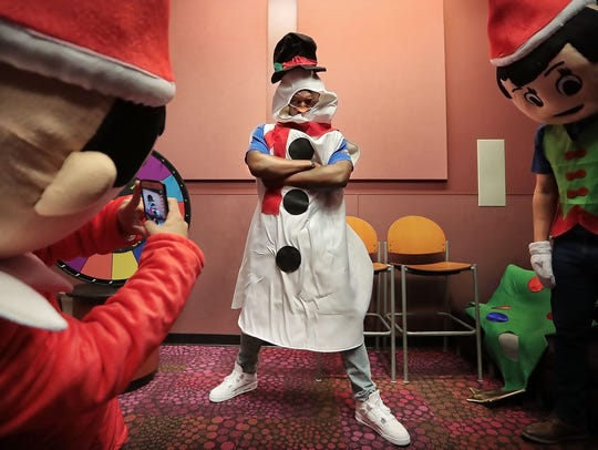 University of Memphis football player Patrick Taylor does his best snowman pose at Le Bonheur Children's Hospital before the start of a closed circuit game show in December 2017