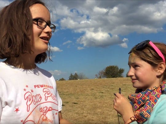 Pirate News Crew member Madison Melter-Gosa (right) interviews fellow student Makenna Otto during Horizon Elementary School's PTO Color Run earlier this year. The segment ran as part of the Pirate News Crew's video news program.