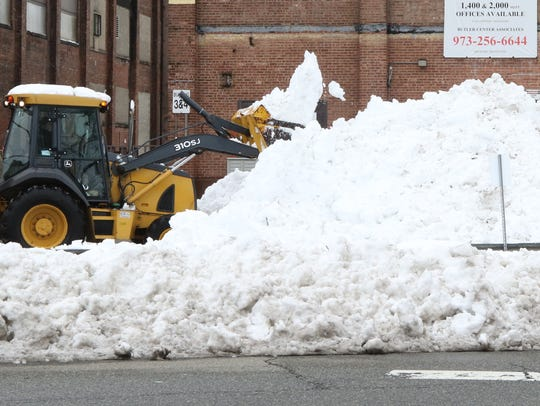 Some of the 25.5 inches of snow being removed from an industrial park on Keil Avenue in Butler after a recent storm.