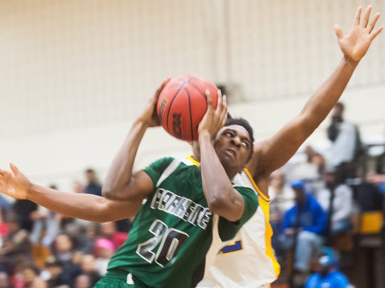 Parkside forward Gary Briddell (20) drives to the basket against Wicomico on Tuesday evening at the Waller Dome in Bayside South action.
