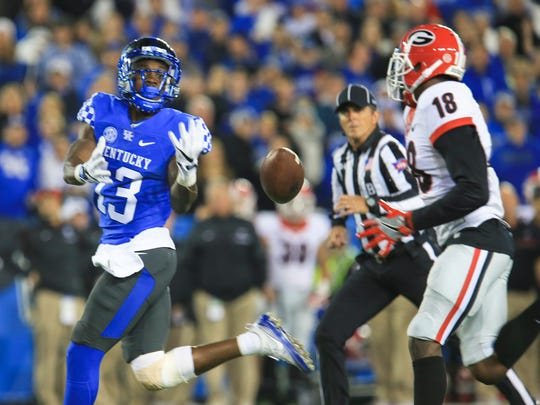 Kentucky's Jeff Badet can't hold onto this pass as it bounces into the arms of Georgia's Deandre Baker Saturday evening, Nov. 5 at Commonwealth Stadium. Errors helped contribute to the Wildcats' 27-24 loss.