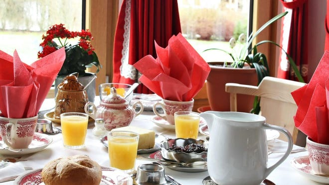 """Many innkeepers have added private tables to the dining room, in case couples would prefer to enjoy breakfast together rather than """"family-style"""" at the table."""