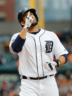 Tigers rightfielder J.D. Martinez celebrates his solo home run in the first inning Saturday at Comerica Park.