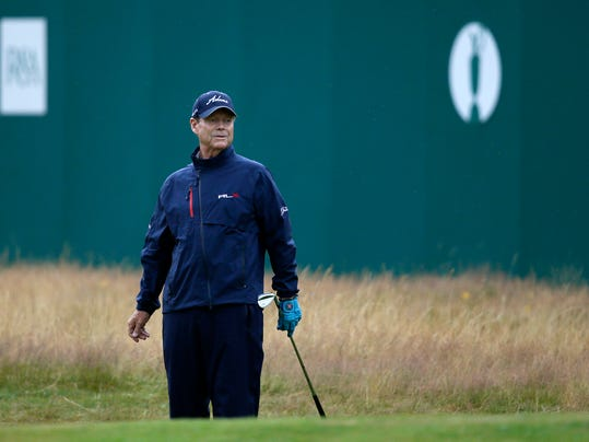Tom Watson of the US watches as his shot almost holes on the 18th green during the third day of the British Open Golf championship at the Royal Liverpool golf club, Hoylake, England, Saturday July 19, 2014. (AP Photo/Alastair Grant)