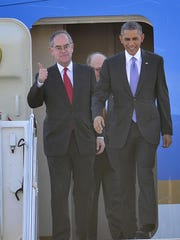 U.S. Rep. Jim Cooper, left, exits Air Force One with President Barack Obama at Berry Field Air National Guard Base in Nashville on Dec. 9, 2014, before a visit to McGavock High School.