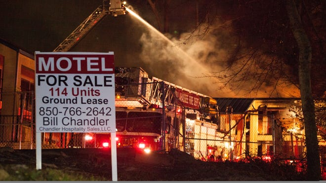 Firefighters with the Tallahassee Fire Department spray water on a burning motel building Feb. 6.
